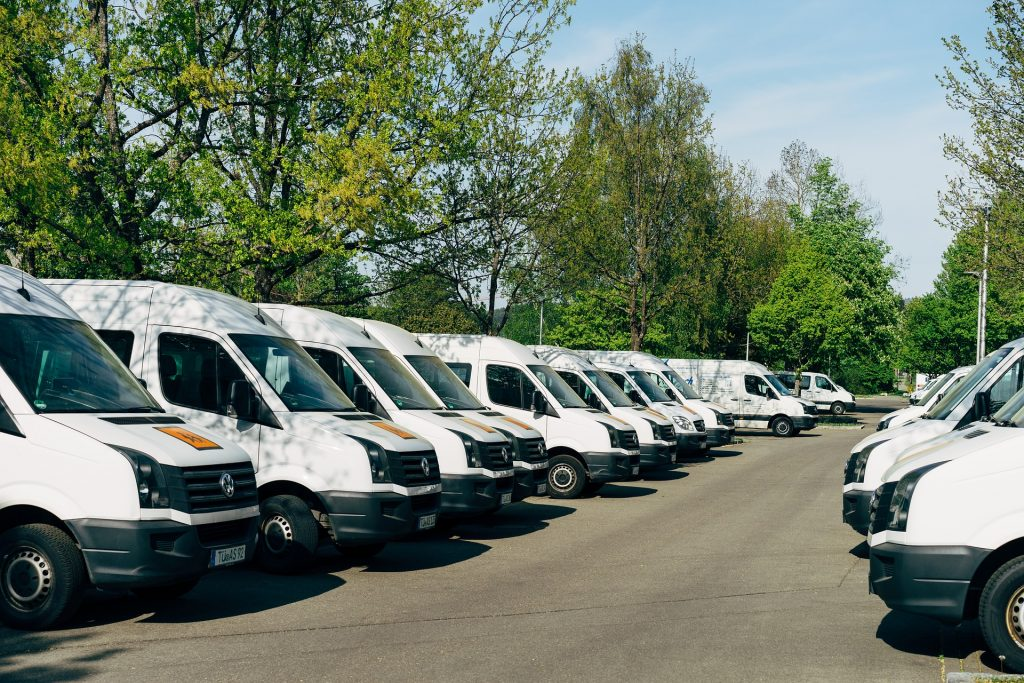 Fleet of vans lined up to be washed.